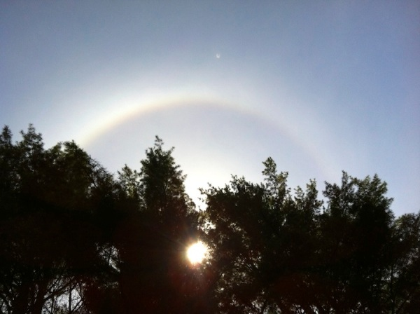 A rainbow halo around the sun, right over our circle