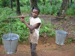 Child worker on Firestone rubber plantation in Liberia