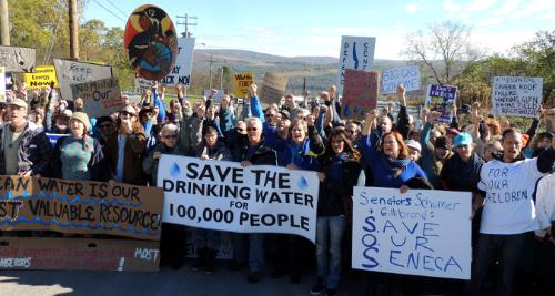 Over four hundred members of We Are Seneca Lake blockade the gates of Crestwood Midstream and stand up to the expansion of dangerous gas storage in the crumbling salt caverns next to Seneca Lake and under the beautiful wine country of the Finger Lakes. Lead by renown biologist, author, Sandra Steingraber. Pictured; Yvonne Taylor, Gas Free Seneca, Doug Couchon, People for a Healthy Environment, Members of Finger Lakes CleanWaters Initiative, Seneca Lake Pure Waters, ShaleShock, DJ Astro Hawk. (PRNewsFoto/We Are Seneca Lake)
